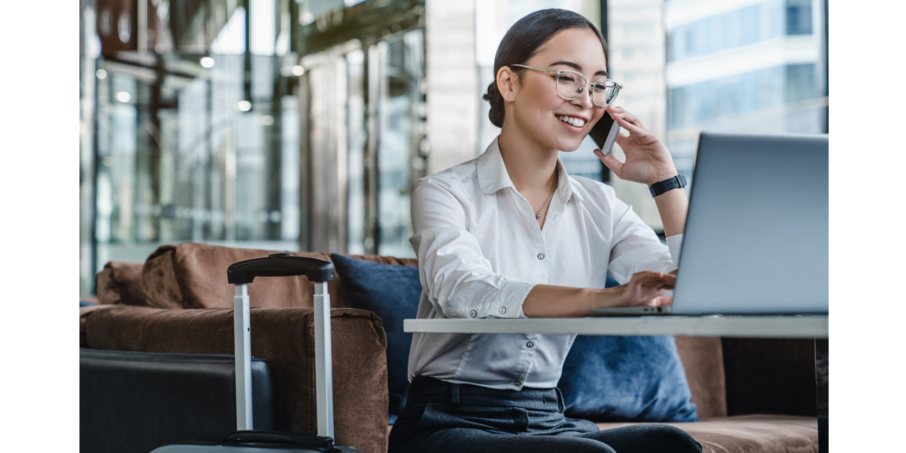 Businesswoman working as she waits for her flight