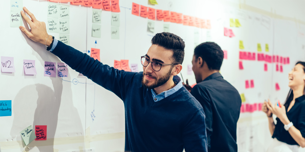 Male businessman making outlining long term planning with sticky notes