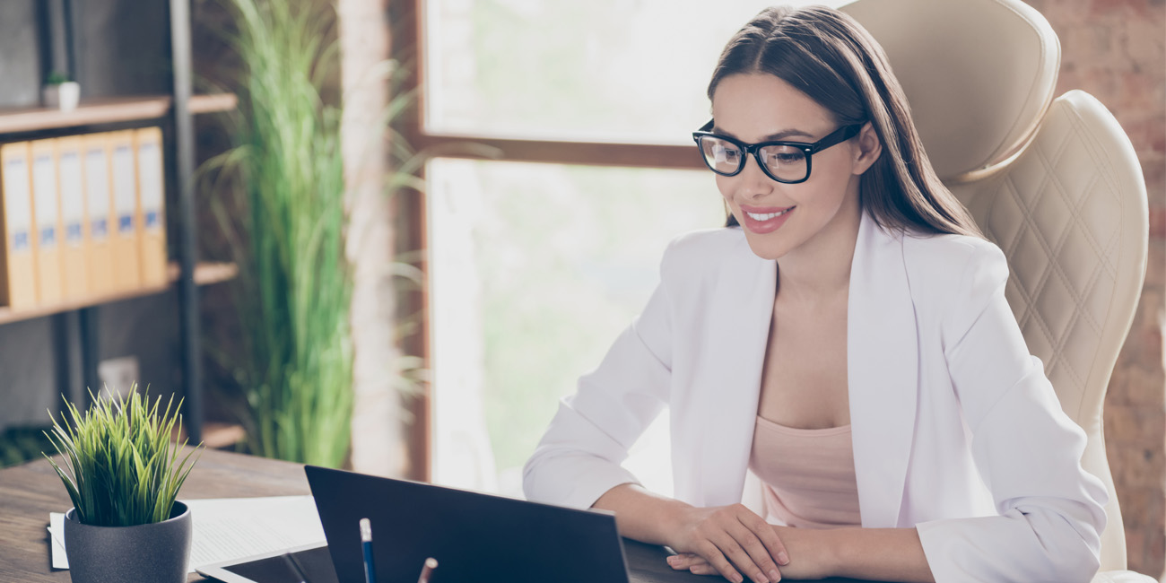 Businesswoman looking on her laptop screen during virtual interview