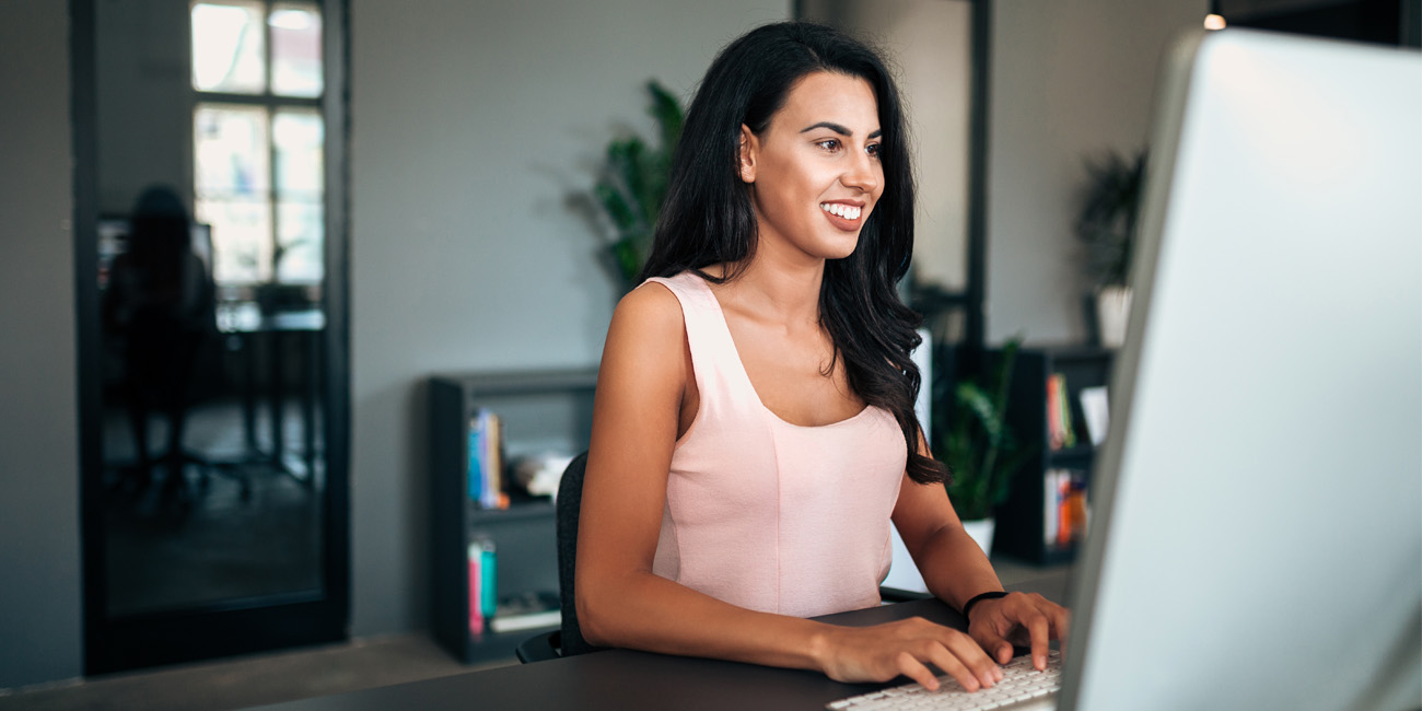 Lovely young business woman learning remotely in order to upskill