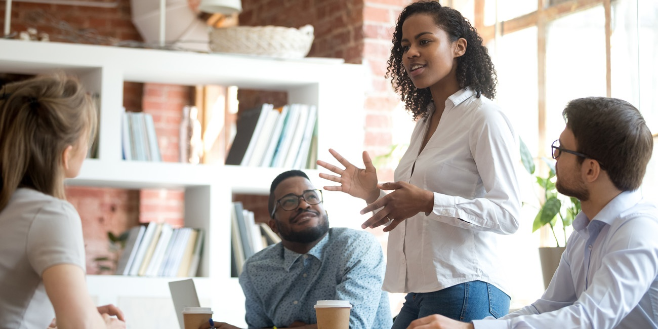 African American female employee speaking positively on political subjects