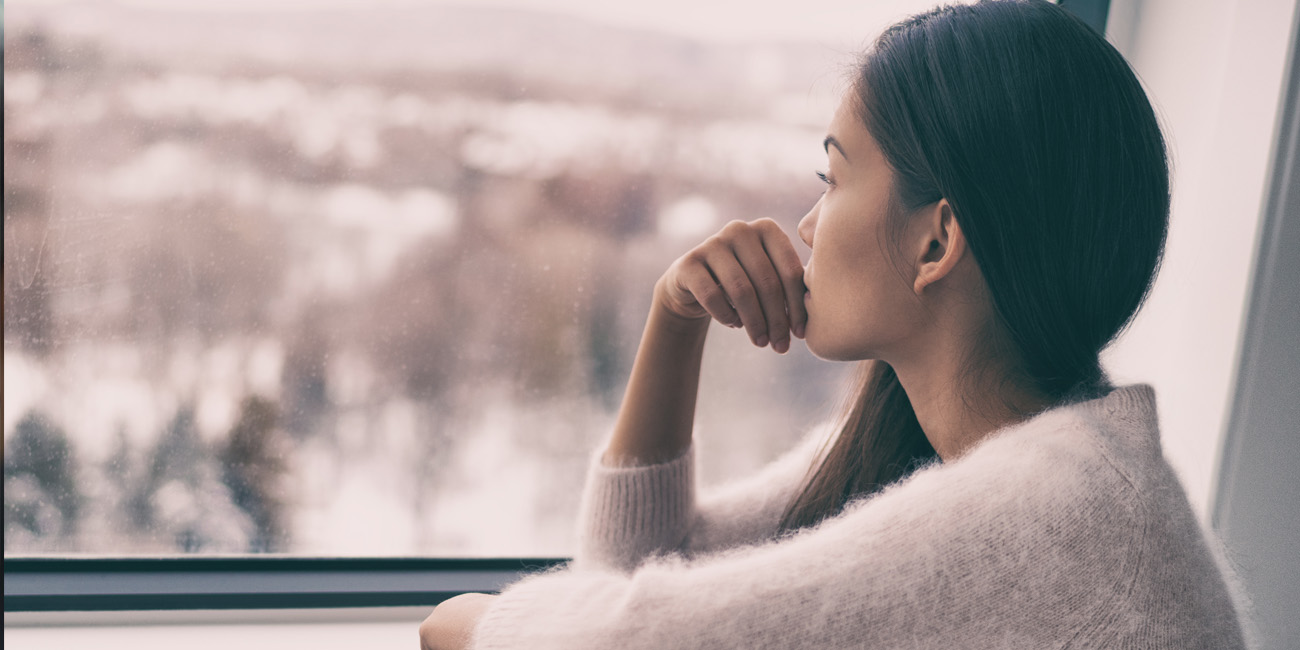Young woman looking out at snowy landscape